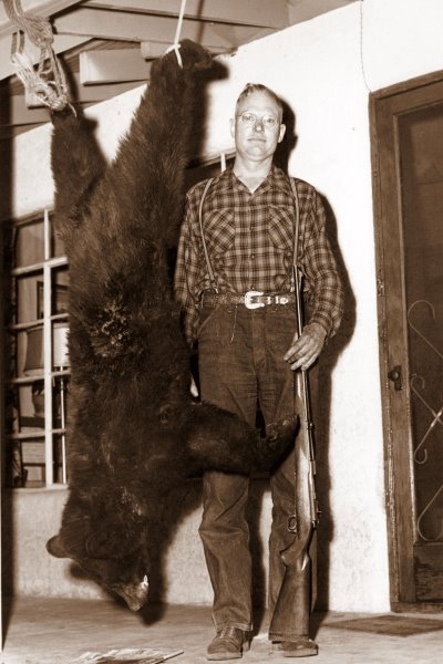 1955 George and bear on the porch in Ruidoso
