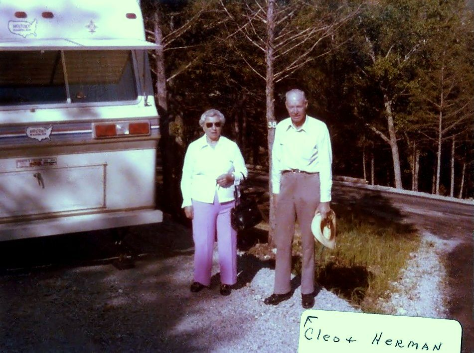 Cleo and Herman by their travel trailer, late 1970s