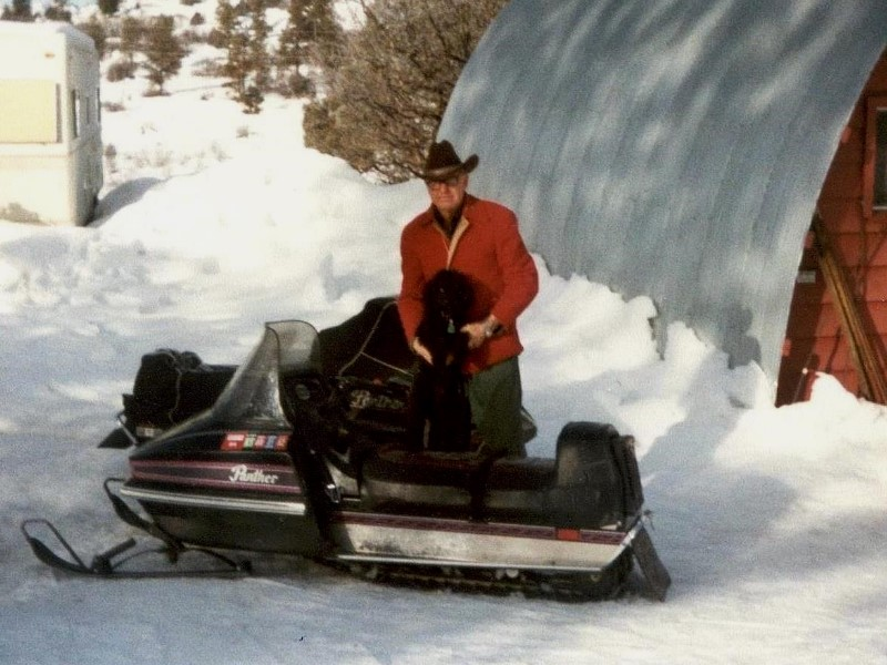 1982 George and his snow mobile at their home in Pagosa Springs