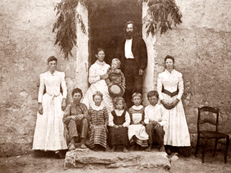 The Fritz Fuchs family in Cypress Mill, 1891:  Bettie, Emil, Anna, Olga, Gini, Fritz, Jr., Julia; in doorway, Theodora holding George, Fritz, Sr